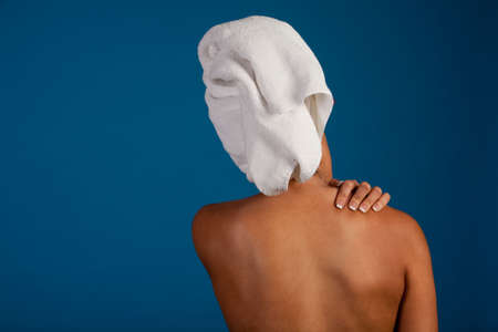 Woman massaging her shoulder to relieve pain Stock Photo - 6840130