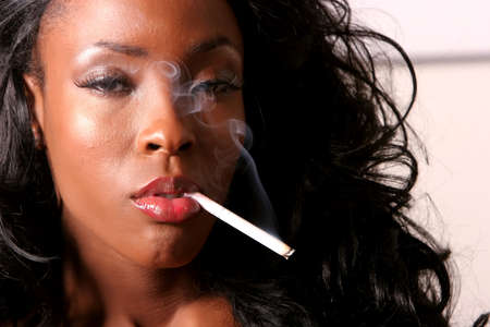 american sexy: Sexy African American young woman smoking cigarette Stock Photo