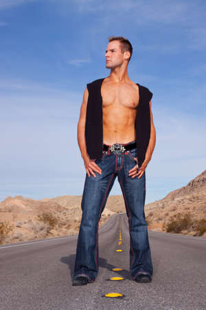 sexy muscular man: Sexy muscular man standing on road Stock Photo