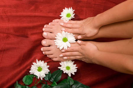 handcare: Hand and feet of a woman Stock Photo