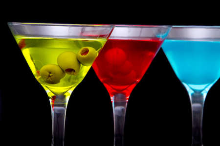 Colorful martini cocktail drinks and green olives