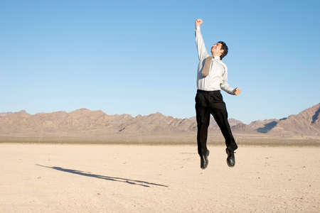 Happy businessman jumping in the air photo
