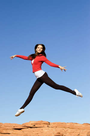 Beautiful young athletic woman jumping high Imagens - 7091088