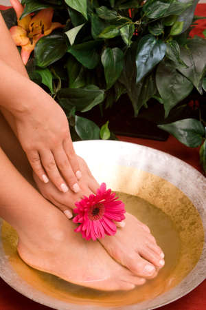handcare: Hand and feet in bowl of water