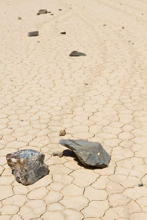 Rocks are movig on desert ground in Death Valley California photo