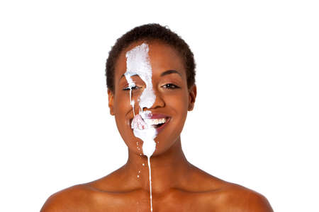 Beautiful young short hair african american womans face covered with milk