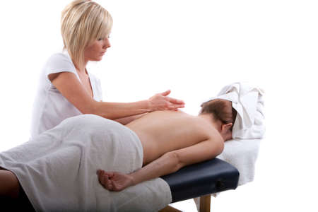 deeptissue: Massage therapist doing a back massage Stock Photo