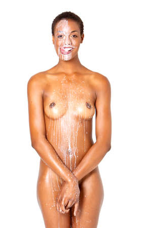 body milk: Beautiful young short hair african american womans face covered with milk