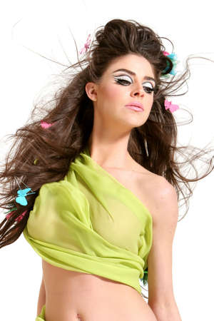 Gorgeous young woman wearing high fashion style makeup and hairdo photo