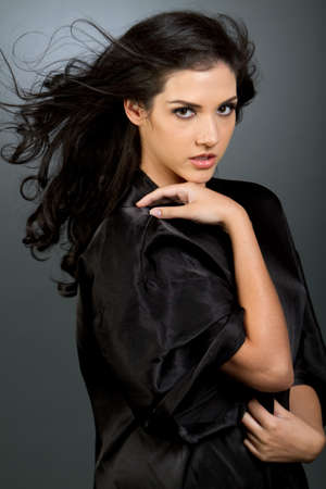 Gorgeous young woman with dark long hair and makeup Banque d'images