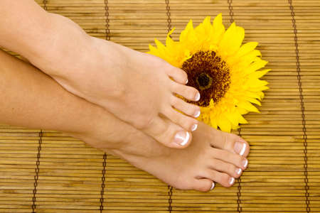 Woman's feet with french pedicure Foto de archivo