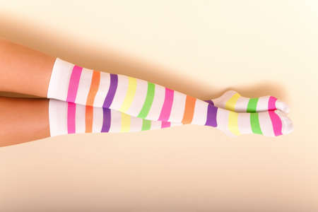 A woman wearing colorful long female socks