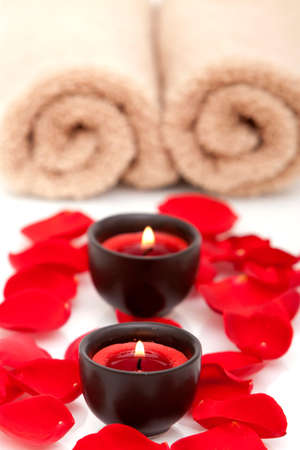 Spa candles and towels with rose petals Banco de Imagens