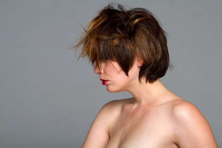 Beautiful young woman with messy short brunette hair style Stock Photo - 7353949