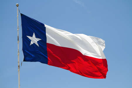 Texas state flag against blue sky