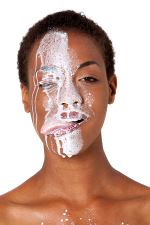 African American woman with milk on her face Banco de Imagens