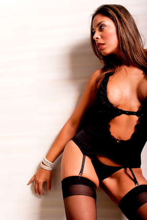 Long hair brunette hispanic woman wearing sexy lingerie