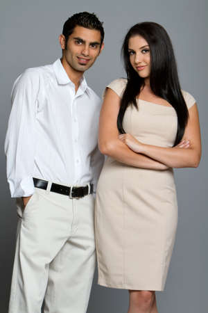 indian business man: Young good looking ethnic couple Stock Photo