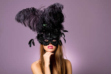 Sexy young woman in fashionable mask