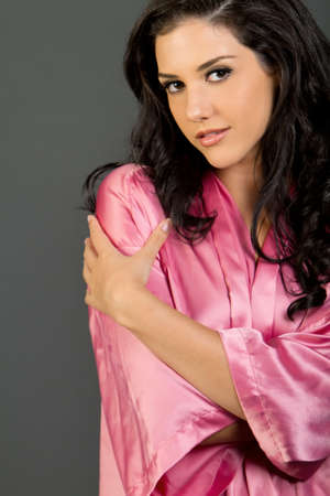 Sexy long dark hair woman with fashionable pink robe photo