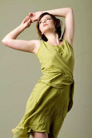 Beautiful young woman in silk dress photo