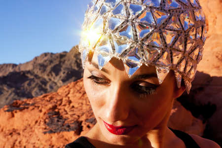 Gorgeous young woman wearing expensive crystal hat photo