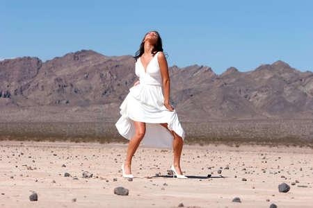 Beautiful woman in dress outdoors photo