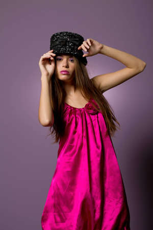 high fashion: Beautiful young long hair brunette woman with high fashion outfit