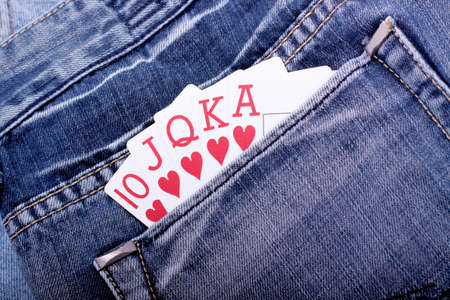 Royal flush with playing cards in blue jeans pocket photo