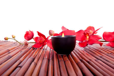 Spa candle and colorful flower for aromatherapy meditation Фото со стока