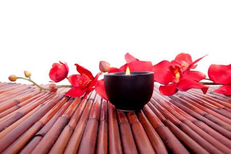 Spa candle and colorful flower for aromatherapy meditation Reklamní fotografie