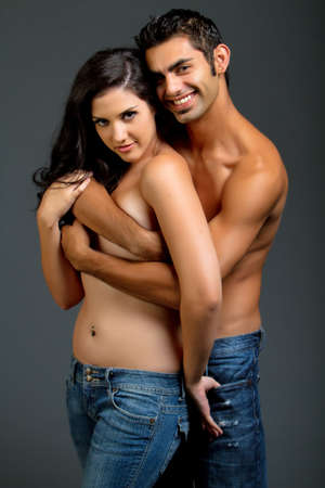 Sexy ethnic couple in blue jeans
