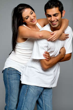 Young ethnic couple having fun on a date photo