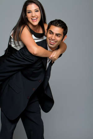Happy young ethnic couple smiling