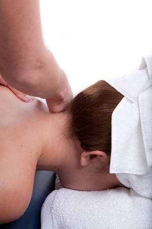 deeptissue: Massage therapist doing a neck massage Stock Photo