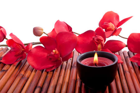 candle: Spa candle and colorful flower for aromatherapy meditation Stock Photo