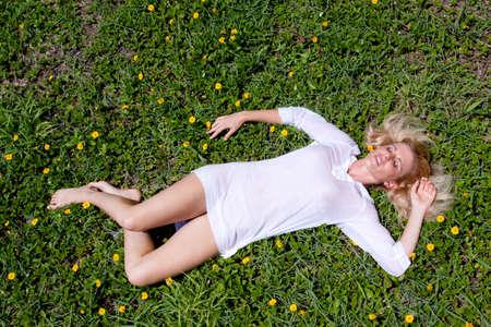 Woman relaxing on lush garden