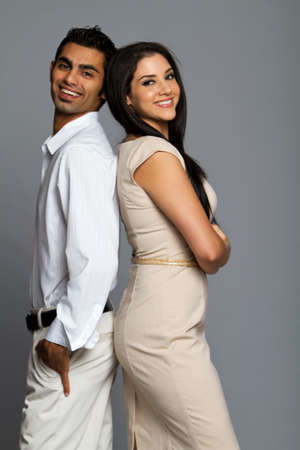 Professional ethnic couple in business clothes photo