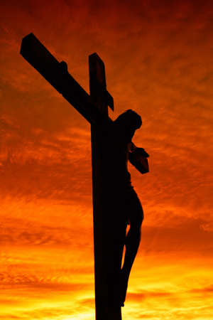 Holy cross at the sunset Stock Photo