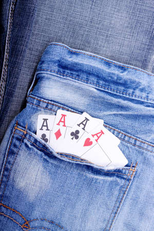 four of a kind: Four of a kind aces in blue jeans pocket