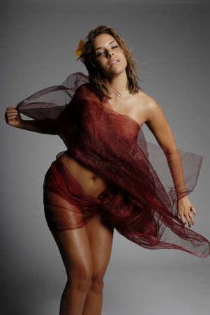 Beautiful sexy woman wrapped in silk fabric photo