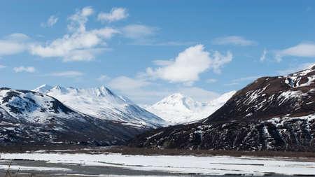 Snow melting on mountains in Alaska photo