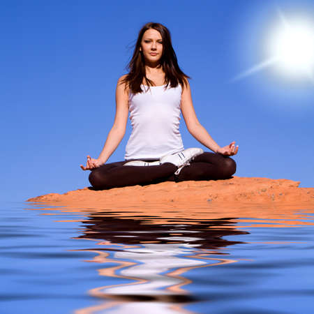 Young attractive woman doing meditation and yoga Фото со стока
