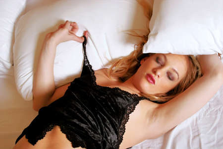 sexy woman on bed: Sexy blonde woman sleeping on bed Stock Photo
