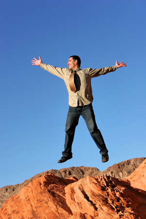 Successful confident businessman jumping with happiness photo