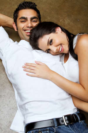 Sexy young ethnic couple in love photo