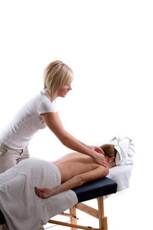 Massage therapist doing a shoulder massage