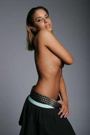 Beautiful sexy woman on gray background photo