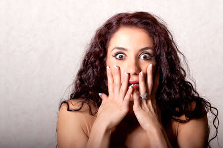 scared girl: Brunette woman with shocked facial expression Stock Photo