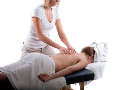 Massage therapist doing a back massage photo